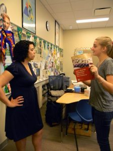 Junior Khaki Loughran quizzes Dr. Paula Pontes on citizenship test questions. Photo: Sydnie Jiang