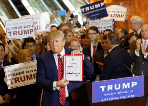 President-elect Donald Trump campaigns to voters and signs Republican loyalty pledge. Photo: Michael Vadon
