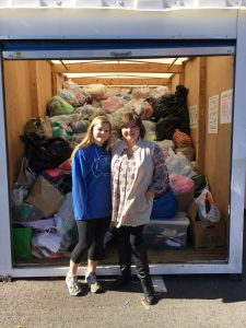 Sophomore Leah Mautner and Head of The Bloom Closet Beck Davenport stand in front of the Pace donations. Photo: Becky Mautner