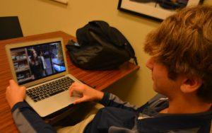 "Sophmore Lawson Stricker watches his favrite show, ""Criminal Minds,"" on Netflix. Photo: Eden Kerker"