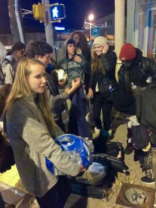 Students hand out sweatshirts and water bottles to the homeless downtown. Photo: Rick Holifield